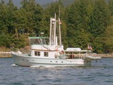 Pau Hana II, 1960s vintage, wood, built in Santa Barbara, still cruising in the Pacific NW